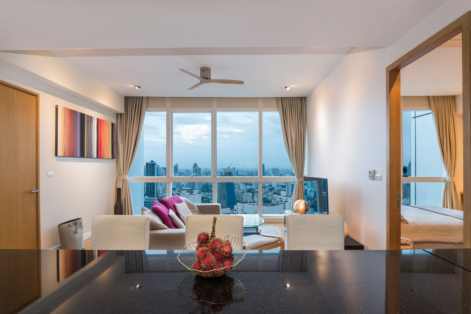Interior photography of an apartment with skyline view in Bangkok, Thailand. Captured by a commercial real estate photographer